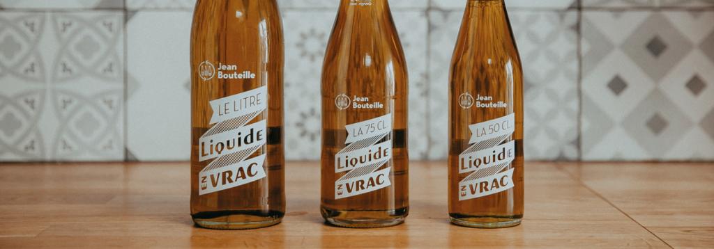 Photos de nos huiles en vrac dans leurs jean bouteilles réutilisables et consignables